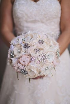 Vintage inspired cream and ivory brooch bouquet                              …