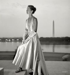 "June 1949. ""Fashion model posing in evening gown on the steps of the Jefferson Memorial against backdrop of Tidal Basin and Washington Monument."" Photo by Toni Frissel"