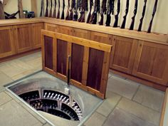 Spiral Wine Cellar in the gun room. Typically guns and alcohol don't mix but in this case....