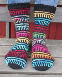 Knitting Pattern for Happy Go Scrappy Socks - This sock pattern is designed to use up all those leftovers from previous socks. Great use for scrap and stash yarn! Designed by Anita Grahn. Available in English, Danish or Swedish
