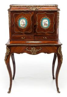 A LOUIS XV-STYLE MAHOGANY, FRUITWOOD AND GILT BRONZE MOUNTED CABINET WITH SÈVRES-STYLE INSETS. Circa 1900