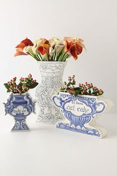 Vases from Anthro. Drawings on foamcore + flowers. Mother's Day gift?