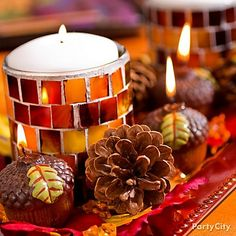 Arrange a tray of seasonal candles for a festive look. Get more inspiration for Thanksgiving crafts & decorations by clicking the picture.
