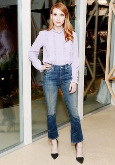 Emma Roberts making an affordable ASOS top look chic with cropped flared denim and pointed toe pumps.