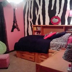 My tween daughter wanted a zebra accent wall! I drew the the stripes freehand with a black dry-erase marker then painted them in!
