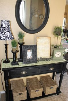 Entryway table...gorgeous display!! Stealing some of these ideas for our table.
