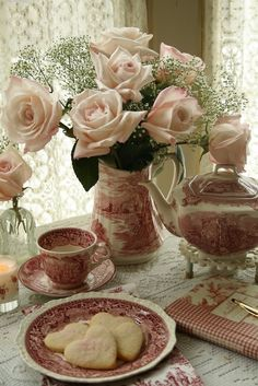Tea, biscuits, and roses. Lovely