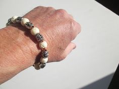 Cool Bracelet featuring Leather, bone and silver beads Cool Surfer, Hippie, Boho, Bohemian Bracelet featuring Leather, bone and silver beads The size is adjustable by sliding the tightening bead to the desired length. Available on Etsy at SpuzzoWoodworking
