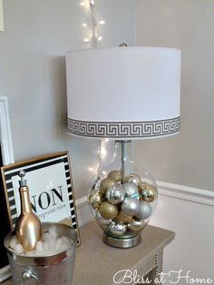 Fill a clear glass lamp with ornaments for the holidays