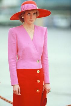 Princess Diana always had such timeless, classic style. Here she is wearing a pink and red color-block dress and hat with gold accents in 1989 and it's SUCH a good spring outfit!