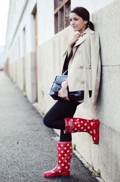 Rainy day with bright red polka-dotted rain boots