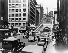 ca. 1937)^ - Cars and pedestrians are seen on 3rd St. On the corner at the bottom of Angels Flight (beside the archway) is a drug store on the bottom floor of the Ferguson Bldg. The rail itself is still on wooden tressels.