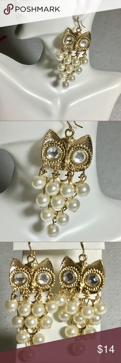 Pearl and rhinestone chandelier owl earrings Gold and pearl colored. Rhinestone eyes. Colors may vary slightly to lighting and photos. Measurements approximately as shown. ❌Smoke and pet free home. ⚡️Same/next day shipping. Save by bundling or make a reasonable offer through the offer button. No trades or modeling. Wrapped and shipped with care. Includes free gift. Jewelry Earrings
