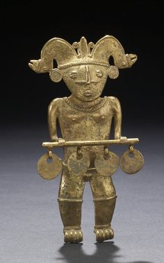 human effigy pendant, ancient america's.colombian, 600 AD