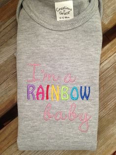 "Embroidered ""I'm a rainbow baby"" onesie"