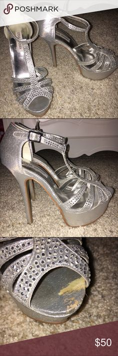 Silver Rhinestone High Heel Pumps These silver pumps are a must have for any formal outing- weddings, prom, homecoming, etc! Even though the heel is high, the platform base makes these so easy to walk in. *Light scoff on left shoe but cannot tell once shoe is on. Steve Madden Shoes Heels