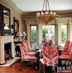 An Italian chandelier, circa 1820, is above an 18th-century Irish hunt table in a New York townhouse's dining room. Decorator Timothy Whealon...