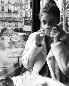 """Taylor Hill at the Café de Flore, looking at things with an appropriately existential twist. """"Modeling is about staying relevant,"""" says Hill. But who defines relevance? At present she exists as a model in two parallel universes. There is the world of Victoria's Secret, where she and her friends work crazy hard and also have crazy fun—and this is a life and a landscape that resonates brilliantly on social media. Then there is Fashion Week, which gives one cred in the industry and with…"""