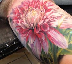 Realistic full colors Flowers tattoo by artist Philip Garcia