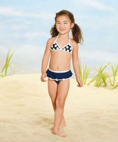Cute daisies cover this charming daisy skirted swimsuit.