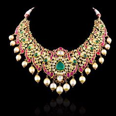 One more of our stunning necklace. The evergreen collection of emeralds, ruby, polkis and pearls. This necklace is a perfect pick for the festive and the upcoming wedding season.   Check more of our magnificent collection on our website www.royalindianjewellery.com    #indian #jewelry #weddings #kundan #jadau #neckpiece #pearls #uncut #diamonds #royal #luxury #class #fashion #ladies #designer #bling #glitter   @gemsjewelspalace Royal Jewelry, India Jewelry, Pearl Jewelry, Jewelry Sets, Diamond Jewelry, Fine Jewelry, Traditional Indian Jewellery, Jewelry Patterns, Jaipur