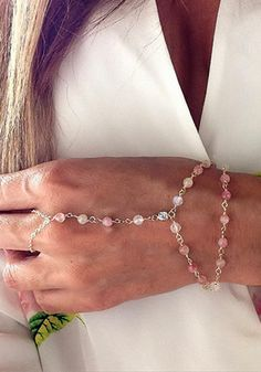 Complete your feminine look in this pink beads slave bracelet. It features pink faux pearl design in layered style and closes with adjustable lobster clasp. | Lookbook Store