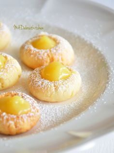 These Lemon Curd Cookies look almost too good to eat! They're light fluffy balls of Cookie Dough baked and then filled with homemade Lemon Curd.