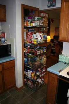 Another super-efficient use of a small space. I like how the spice rack is mounted inside the door. Kitchen Cupboards, Kitchen Pantry, Pantry Room, Cabinets, No Pantry Solutions, Tiny Pantry, Roll Out Shelves, Lowes Home, Happy Kitchen
