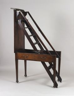 Antique table folds out to a ladder. This would be the perfect library table!!!