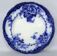 """Flow Blue: a style of white earthenware, sometimes porcelain, that originated in the Regency era, sometime in the among the Staffordshire potters of England. The name is derived from the blue glaze that blurred or """"flowed"""" during the firing process."""