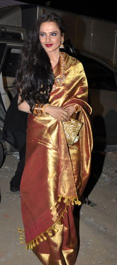 Erstwhile Bollywood diva, Rekha - well in her 60s but still noted for her impeccable choice of saris and flamboyance.