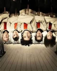 Photoshoot: My Chemical Romance in straight jackets and upside-down. Bob Bryar, Frank Iero, Gerard Way, MikeyWay, Ray Toro.