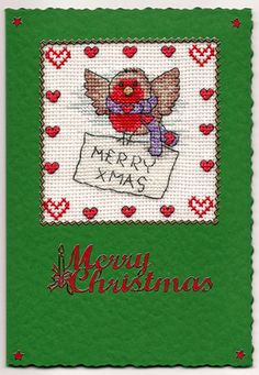 Handmade Christmas Card gift idea by Jean Ashcroft found on MyOwnCreation: Green card with a Christmas theme depicting a Robin with a Christmas Message.Completed cross stitch on 14 count aida fabric using DMC stranded cotton.Card size: A6 105mm x 143mm (approx 4