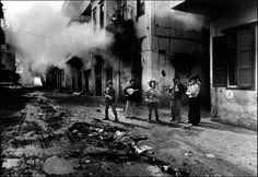 Lebanon civil war, young Christians with the body of a Palestinian girl, Beirut, Lebanon, 1976, © Don McCullin