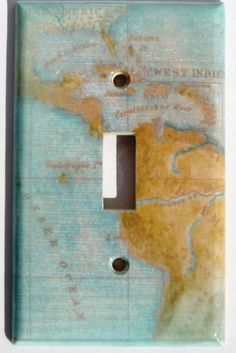 Light switch plate decorated with an aqua map.