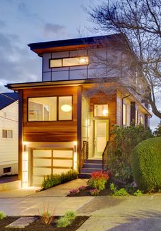 Fremont Modern Home, modern glass and aluminum garage door.