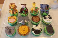 Jungle animal cupcakes - These cupcakes were made for a boys 2nd birthday. The larger 3D animals were held on to the cupcakes by inserting lollipop sticks into the animals then pushing into the cupcake to hold them centered. Got the idea from a mixture of stuff that I found online and some of my own ideas.   Thank you for all the positive comments.
