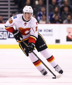 Matthew Tkachuk of the Calgary Flames skates against the Vancouver Canucks during their NHL game at Rogers Arena on October 15 2016 in Vancouver...