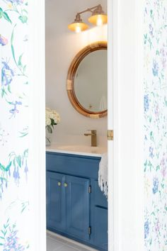 See how we transformed a dark, dated bath with fresh new nautical bathroom decor in this bathroom refresh with a beautiful blue hue! Nautical Bathroom Mirrors, Nautical Bathroom Accessories, Traditional Bathtubs, Nautical Lighting, Painted Vanity, Modern Country, Paint Colors, Hue, Fresh