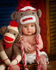 I want the baby!!  How precious!!  In case you want the sock puppet or hat, you can find them on ebay. LOL