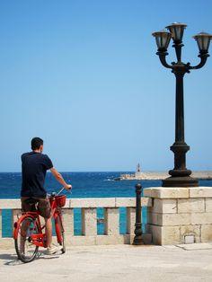 Checking the beach on a red bike...somewhere in Otranto (Puglia - Italy) photo by Passionidivita