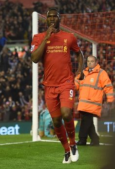 Liverpool's Christian Benteke celebrates after scoring his team's first goal during the English Premier League football match between Liverpool and Chelsea at Anfield in Liverpool, north west England on May 11, 2016. / AFP / PAUL ELLIS / RESTRICTED TO EDITORIAL USE. No use with unauthorized audio, video, data, fixture lists, club/league logos or 'live' services. Online in-match use limited to 75 images, no video emulation. No use in betting, games or single club/league/player publications…