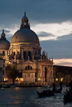 The Salute church at dusk, with gondola. Venezia, Italy.