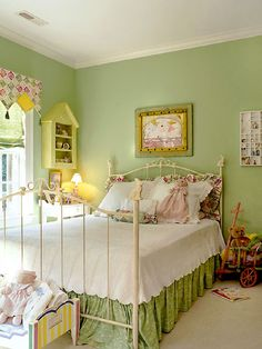 Pink and Green for Spring **** Pretty pastels and thoughtful details characterize the springlike feel of this bedroom. Candy-colored pink and green coat the room, and bunny rabbits scamper in every corner.