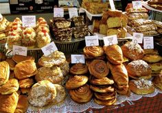 Shop at the best street markets in London: Tempting cakes and pastries at Old Spitalfields Market.