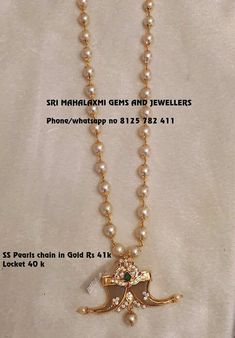 Beautiful pearl long haaram with puli gore locket. Locket studded with precious stones. Locket having pearl hanging in the center. 12 May 2018 Mens Gold Bracelets, Mens Gold Jewelry, Gold Jewelry Simple, Gems Jewelry, Pearl Jewelry, Baby Jewelry, Jewelery, Jewelry Necklaces, Antique Jewellery Designs