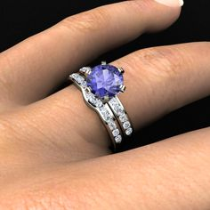 Claire Ring and matching band. Tanzanite Center Stone, with diamond accents, in 14K white gold.