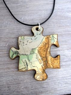 pendant / necklace - lasercut, old map - piece of the world | CreativeUseofTechnology - Jewelry on ArtFire