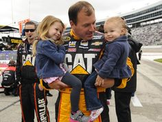 Ryan Newman, holds his daughters Brooklyn, left, and Ashlyn before the Texas 500 on April 7, 2014.