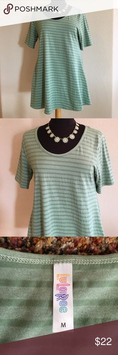 """LuLaRoe sage green mini/tunic!🌿🌱🌿🌱 This is so cute, it has never been worn. I washed it but decided it's not my color. 19"""" across bust, 30"""" length. It would also be a great mini dress  with boots. 38"""" wide bell shape at the bottom with 6"""" slits gives it lots of flair and fun. Super soft & stretchy, see pic 4 with fabric blend. Love it! 😊 LuLaRoe Dresses Mini"""